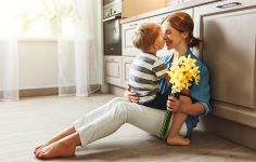 Happy mum and son in kitchen